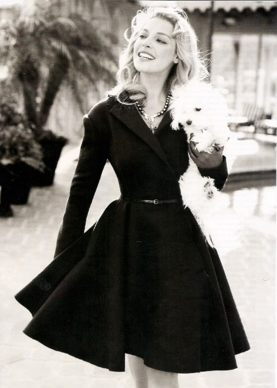 Heigl with small white dog