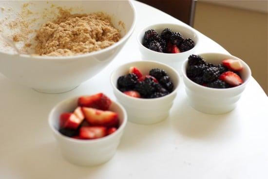 Cobbler dough and berries in ramekins