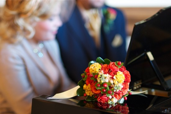 wedding bouquet and couple playing piano