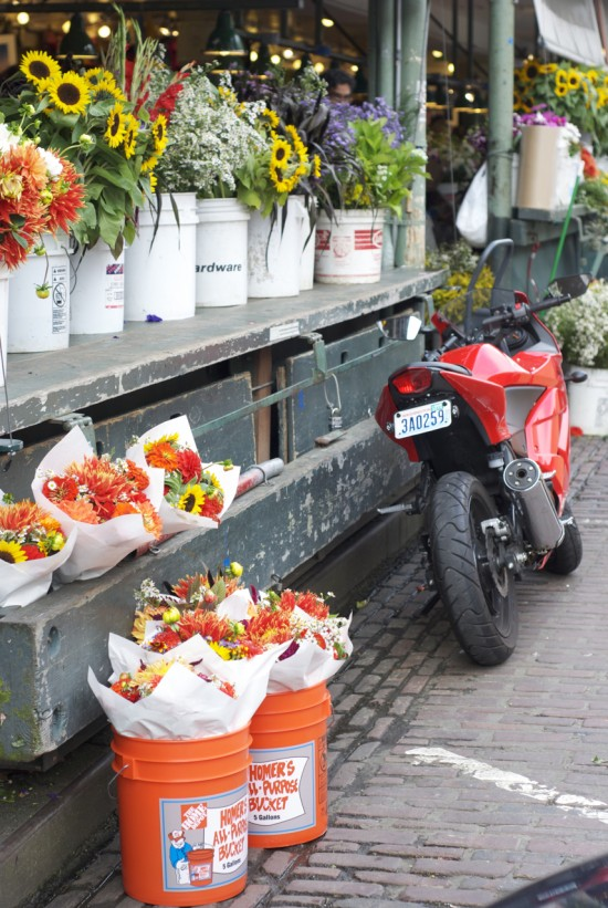 Flowers and a motorcycle at Park Place Market.