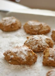 baked pumpkin cookies topped with powdered sugar