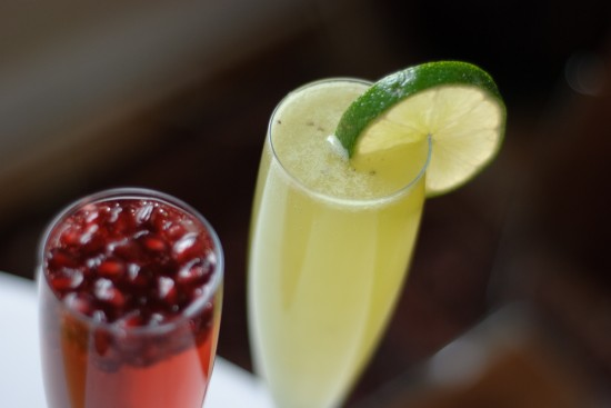 kiwi lime champagne cocktail with pomegranate prosecco