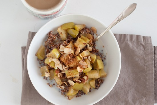 breakfast quinoa with granny smith apples, apple sauce, coconut and almonds