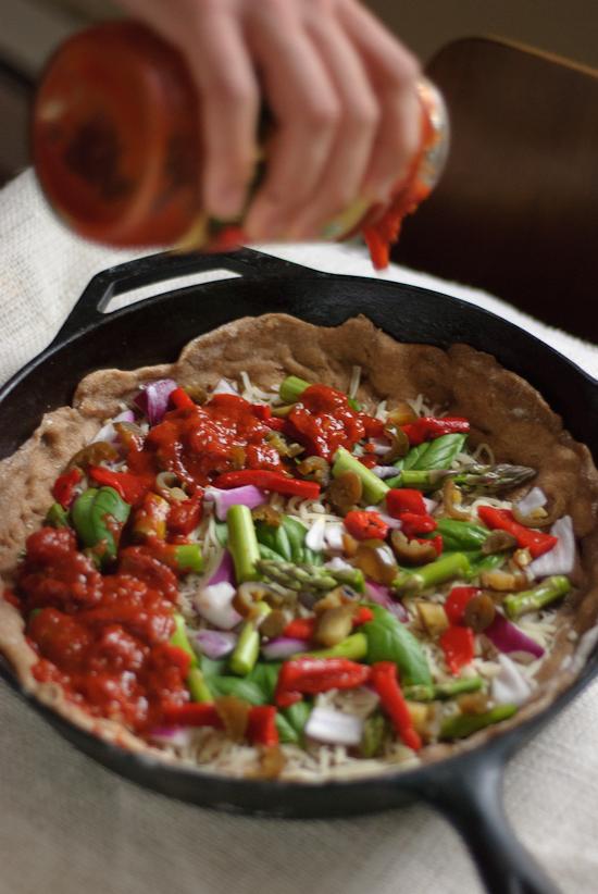 deep dish pizza with arugula