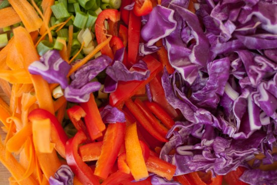 diced red bell pepper, cabbage, carrots and green onions