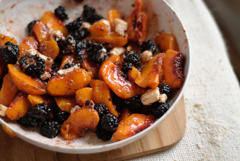 blackberry peach galette filling with raw sugar, butter and honey