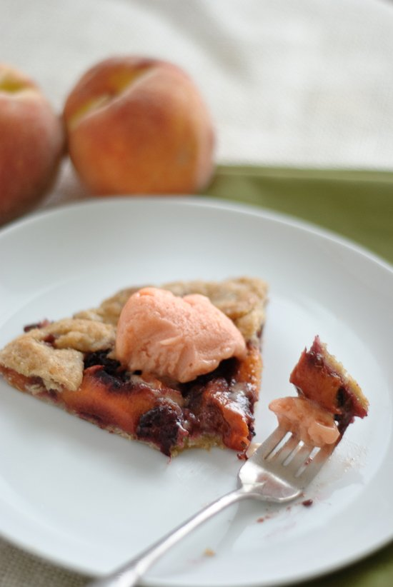 blackberry peach galette topped with peach sorbet