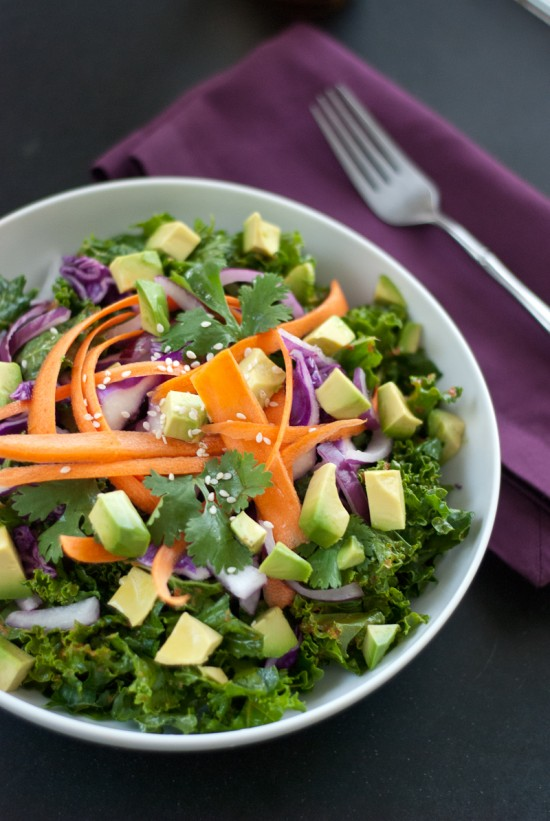 Kale salad with avocado, carrots, and ginger-red pepper dressing