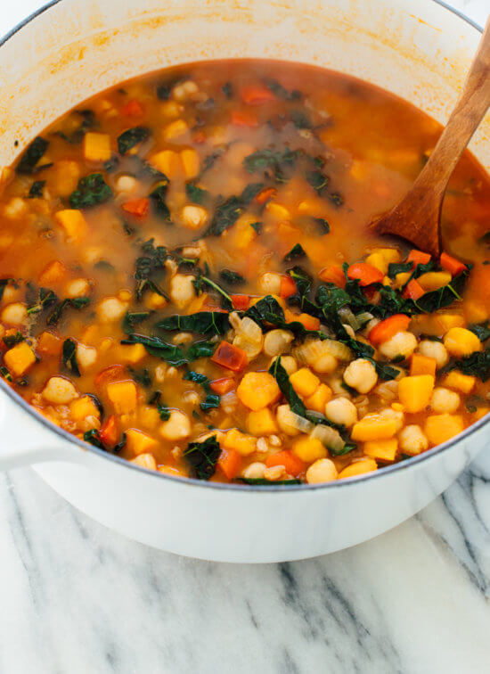 Warm up with this hearty sweet potato, kale and chickpea soup!