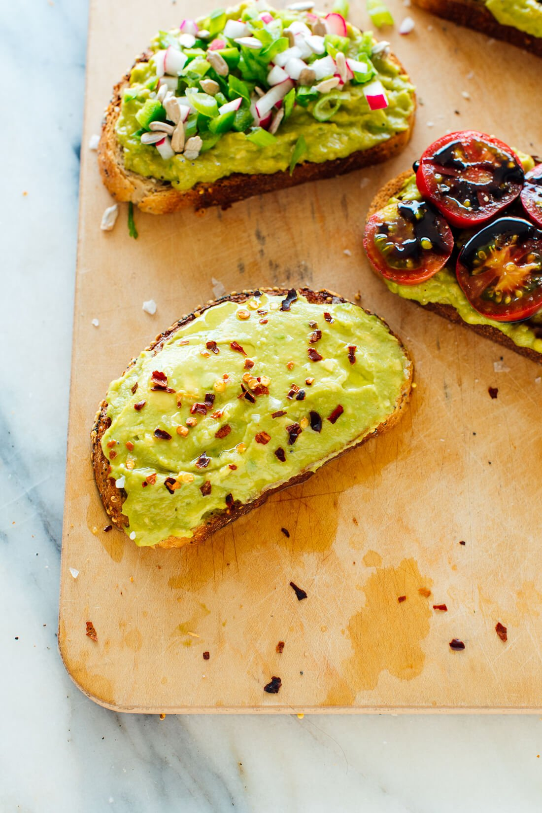 avocado toast with red pepper flakes, lemon juice and olive oil