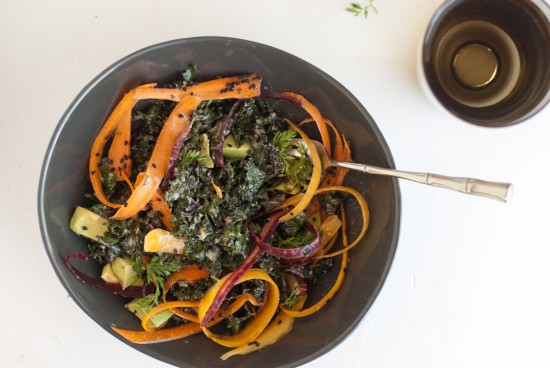 raw kale salad with tahini dressing, carrots and avocado