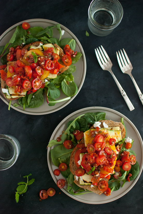 stacked summer salad recipe with tomatoes, zucchini, red bell pepper and goat cheese