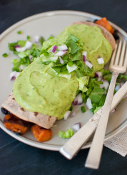 Sweet potato burrito smothered with avocado verde sauce