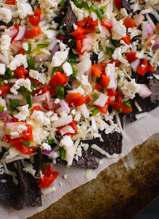 vegetarian nachos with roasted red pepper, jalapeno, red onion and feta cheese