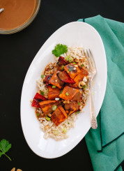 Spicy Thai Peanut Sauce over Roasted Sweet Potatoes and Rice - cookieandkate.com