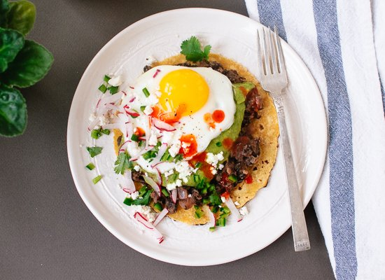 Huevos rancheros with avocado salsa verde and black beans