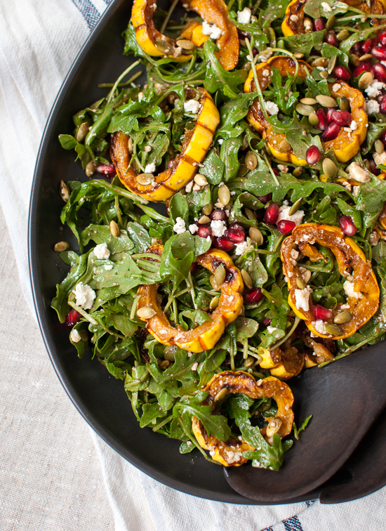 Roasted delicata squash, pomegranate and arugula salad with maple balsamic dressing