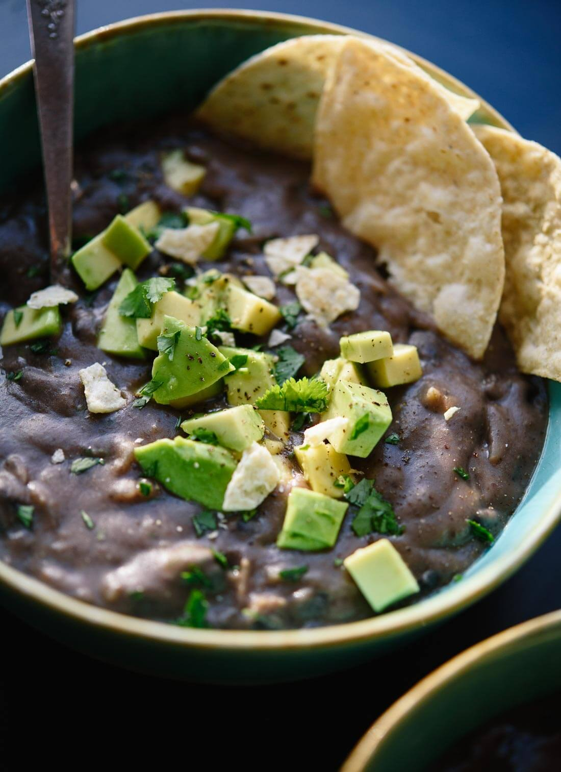 Delicious black bean soup made with basic pantry ingredients! cookieandkate.com