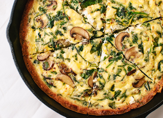 Cremini mushroom and arugula quiche in a gluten-free almond meal crust