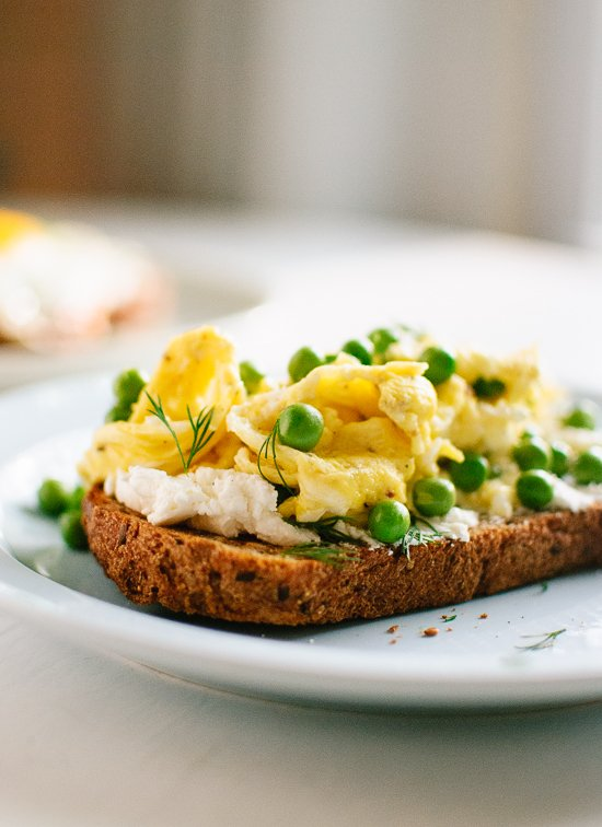 Scrambled eggs and  goat cheese on toast with fresh peas and dill - cookieandkate.com