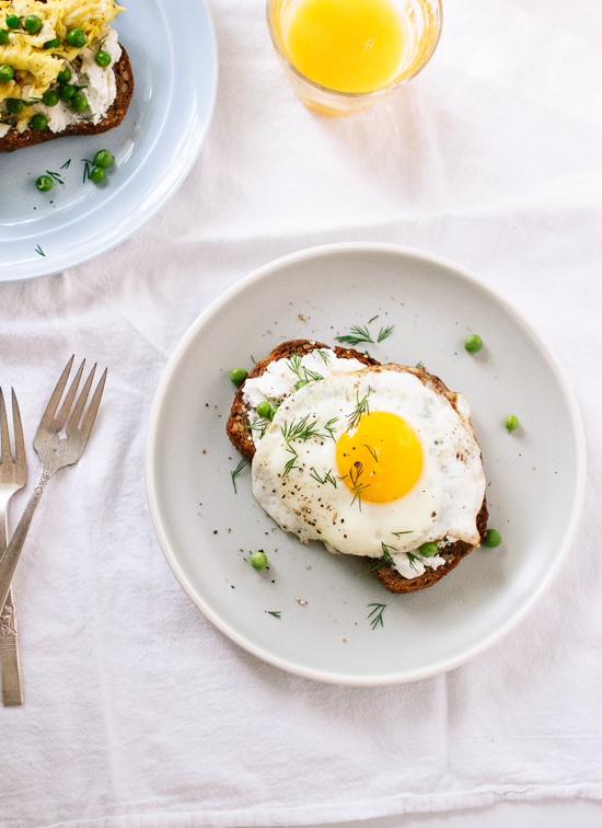 A simple spring meal featuring goat cheese on toast with eggs, fresh peas and herbs - cookieandkate.com