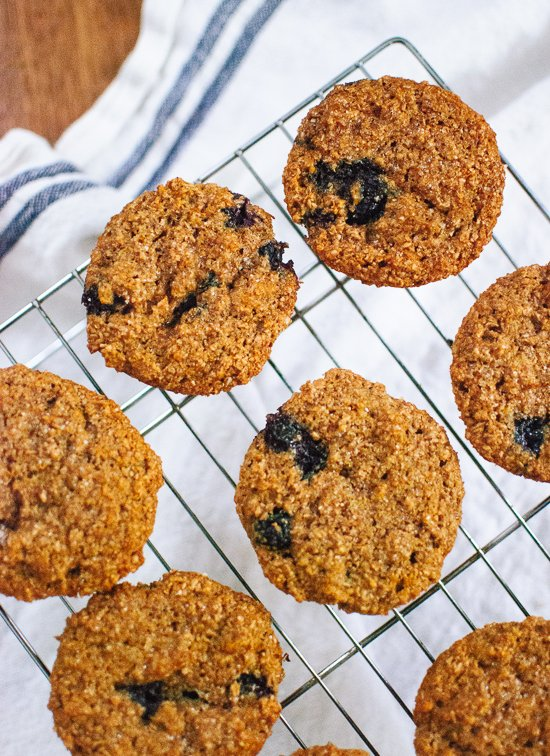 Honey sweetened, whole grain, blueberry bran muffins - cookieandkate.com