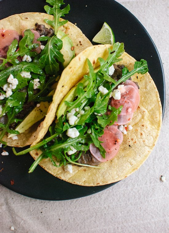 Fresh arugula and black bean tacos with pickled radish and feta - cookieandkate.com