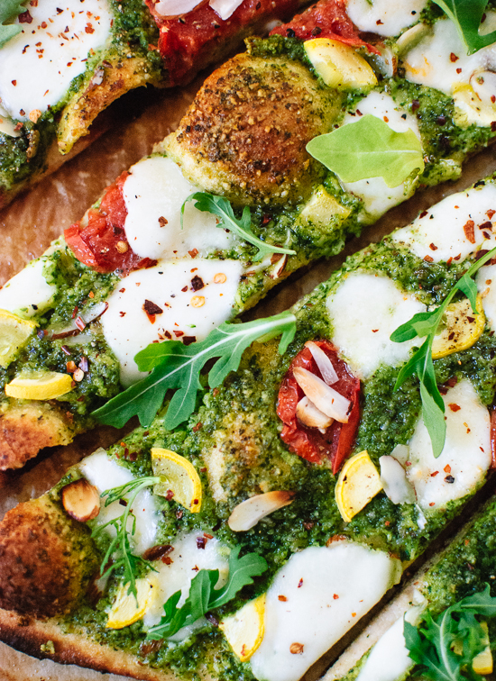 Summertime arugula-almond pesto pizza with a simple whole wheat crust - cookieandkate.com