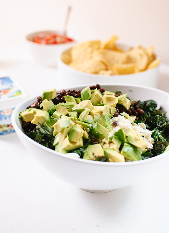 Healthy kale salad with avocado and crispy tortilla strips ...
