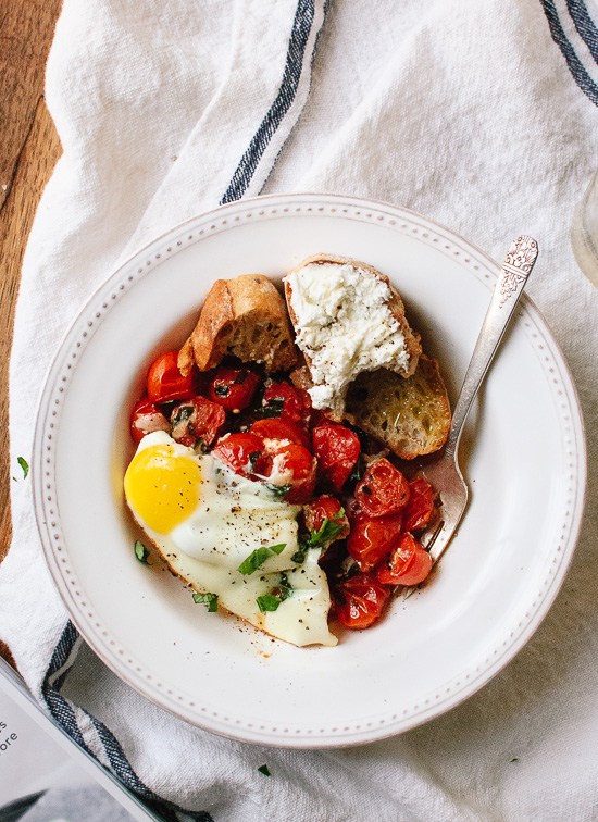 Baked egg on bed of roasted cherry tomatoes - cookieandkate.com