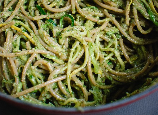 pesto tossed with spaghetti and zucchini ribbons - cookieandkate.com