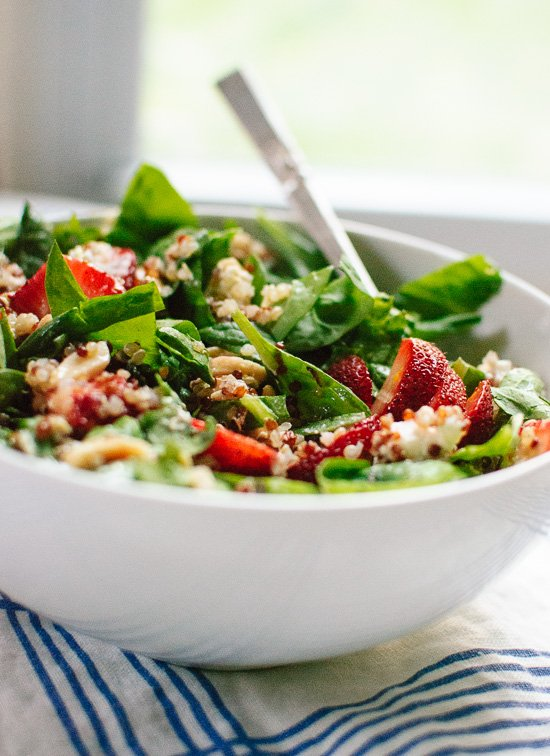 Light summer salad recipe featuring strawberries, spinach, quinoa, almonds and goat cheese - cookieandkate.com