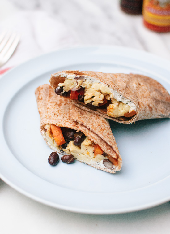 Healthy freezer breakfast burritos with sweet potato hash, black beans and scrambled eggs! Make some now and freeze extra burritos for busy mornings. cookieandkate.com