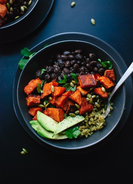 Roasted sweet potatoes with healthy green rice and black beans. Delicious! cookieandkate.com