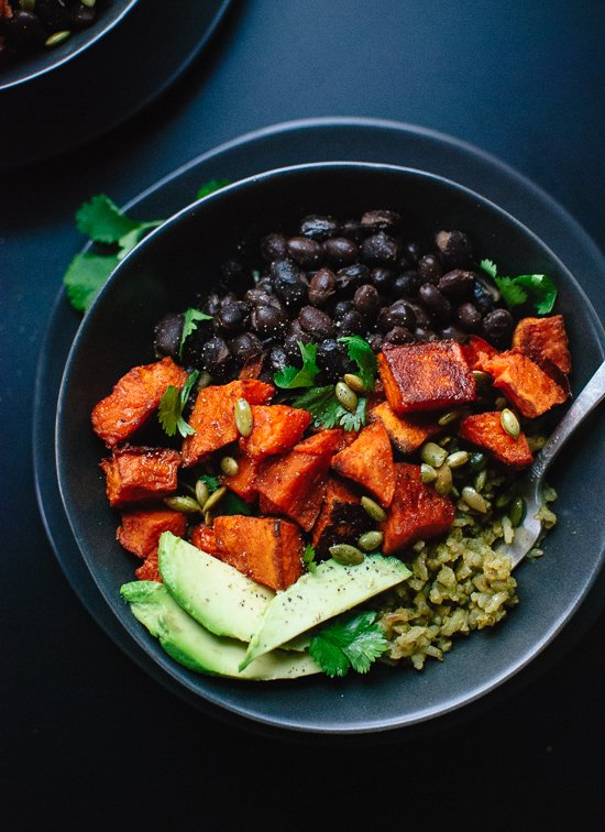 Roasted sweet potatoes with green rice and black beans. familycuisine.net