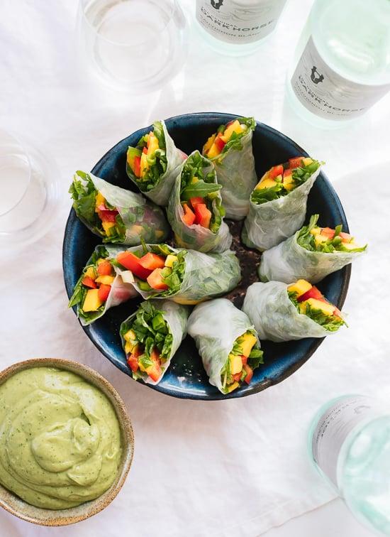 Fresh mango spring rolls with avocado cilantro sauce - cookieandkate.com