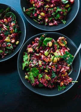 Raw Beet Salad with Carrot, Quinoa & Spinach in bowls