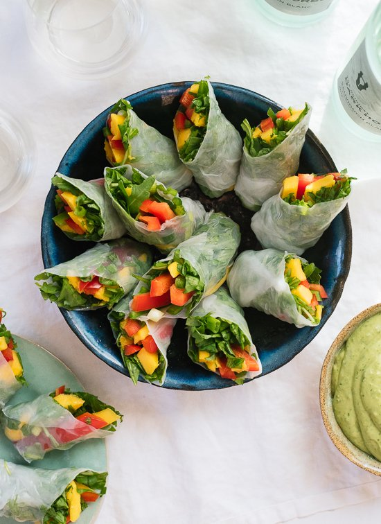 Tropical mango spring rolls with avocado cilantro sauce, a fresh appetizer to serve at your spring/summer parties! Gluten free and vegan. - cookieandkate.com