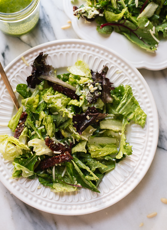 This simple basil pesto vinaigrette pairs marvelously with green salads and bright summer flavors! cookieandkate.com