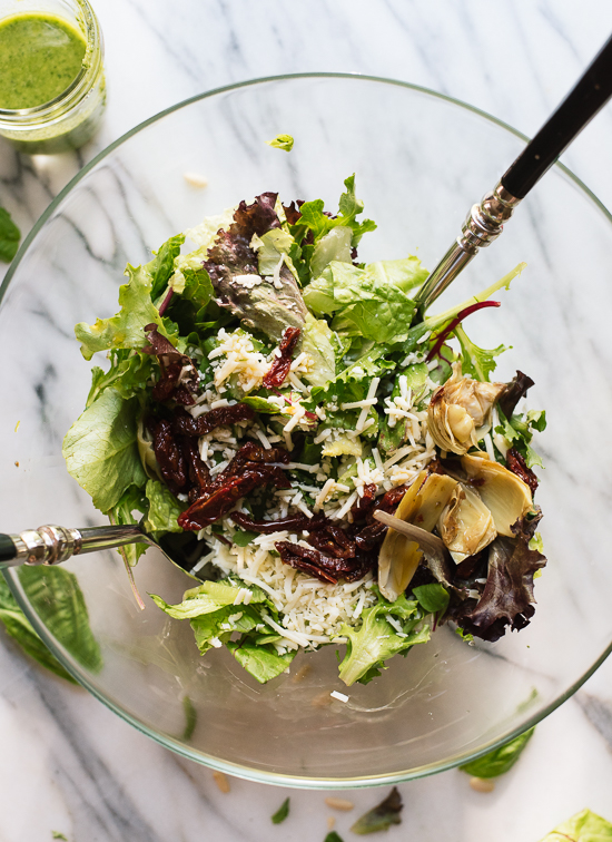 Green salad with basil pesto vinaigrette and DeLallo Salad Savors - cookieandkate.com