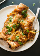 spinach artichoke enchiladas with a simple homemade red sauce