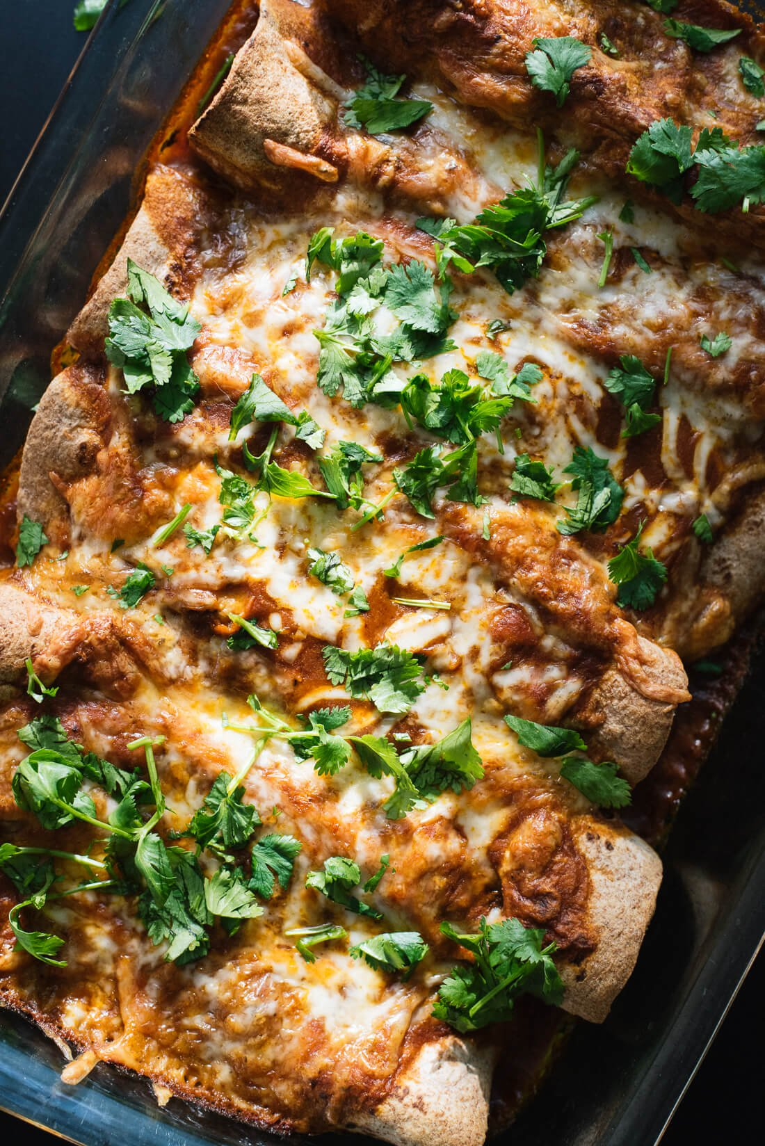 Vegetarian spinach, artichoke and black bean enchiladas with a simple homemade red sauce