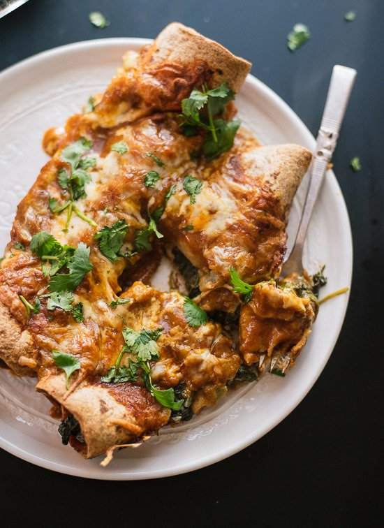 Hearty spinach artichoke enchiladas with a simple homemade red sauce! - cookieandkate.com