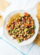 This homemade cowboy caviar is a popular Southern bean salad/salsa. It's always a hit at summer potlucks and it's healthy, too. cookieandkate.com