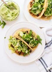 Quinoa black bean tacos with avocado crema! Quick, easy and delicious. cookieandkate.com
