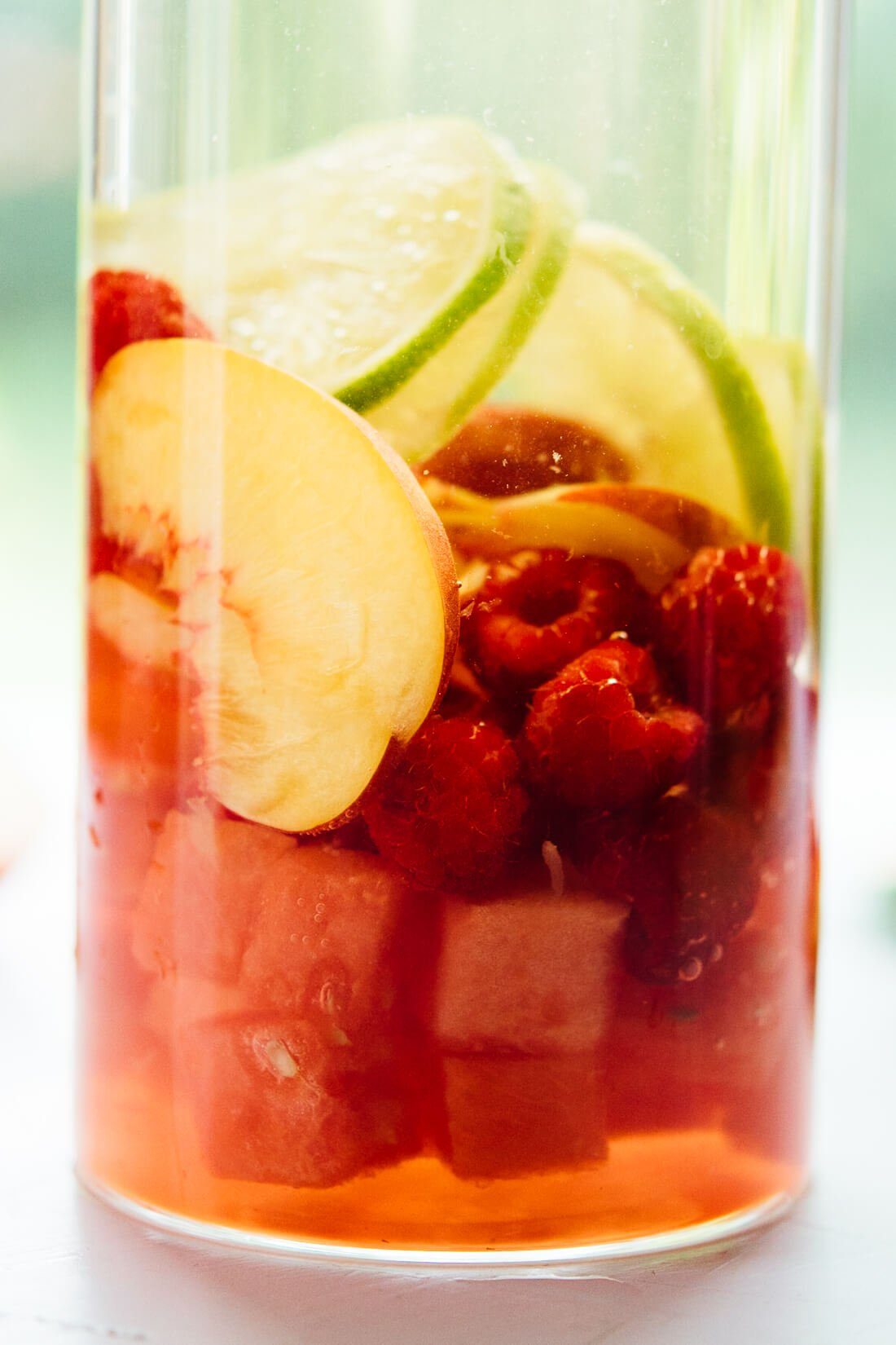 white sangria recipe with nectarine, lime, raspberry and watermelon