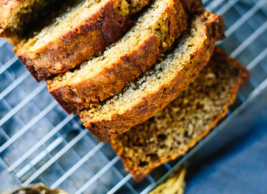 Healthy banana bread—it's so fluffy, moist and delicious that no one will be able to tell! cookieandkate.com