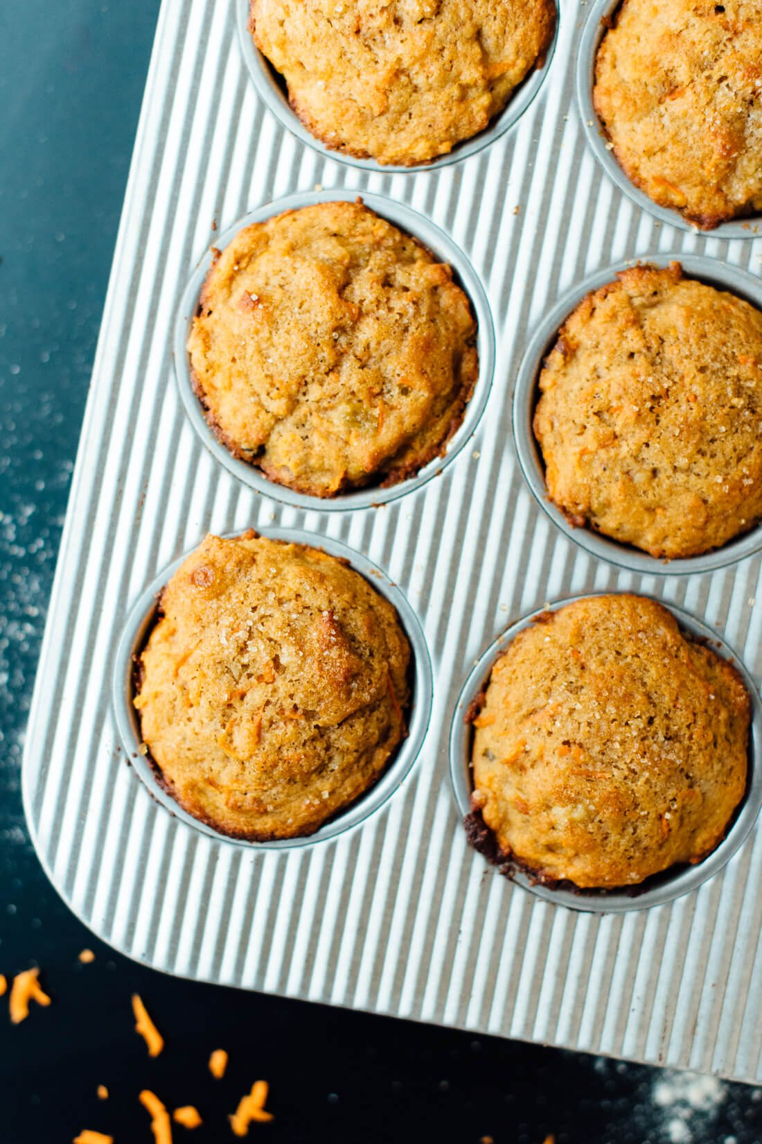 Healthy carrot muffins made with whole wheat flour, coconut oil and maple syrup