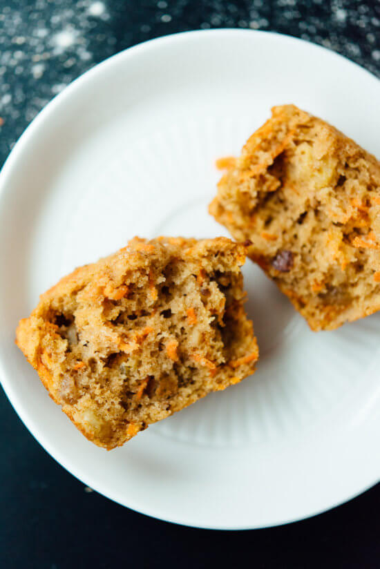 Healthy carrot muffins that taste amazing! These are made with whole wheat flour and sweetened with maple syrup!