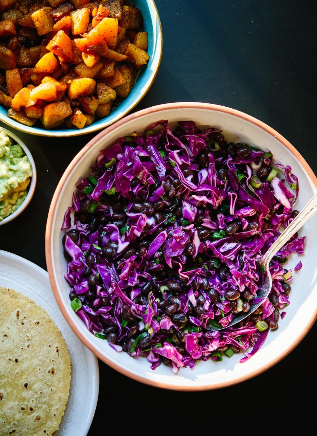 Super easy lime-marinated cabbage and black bean slaw - cookieandkate.com